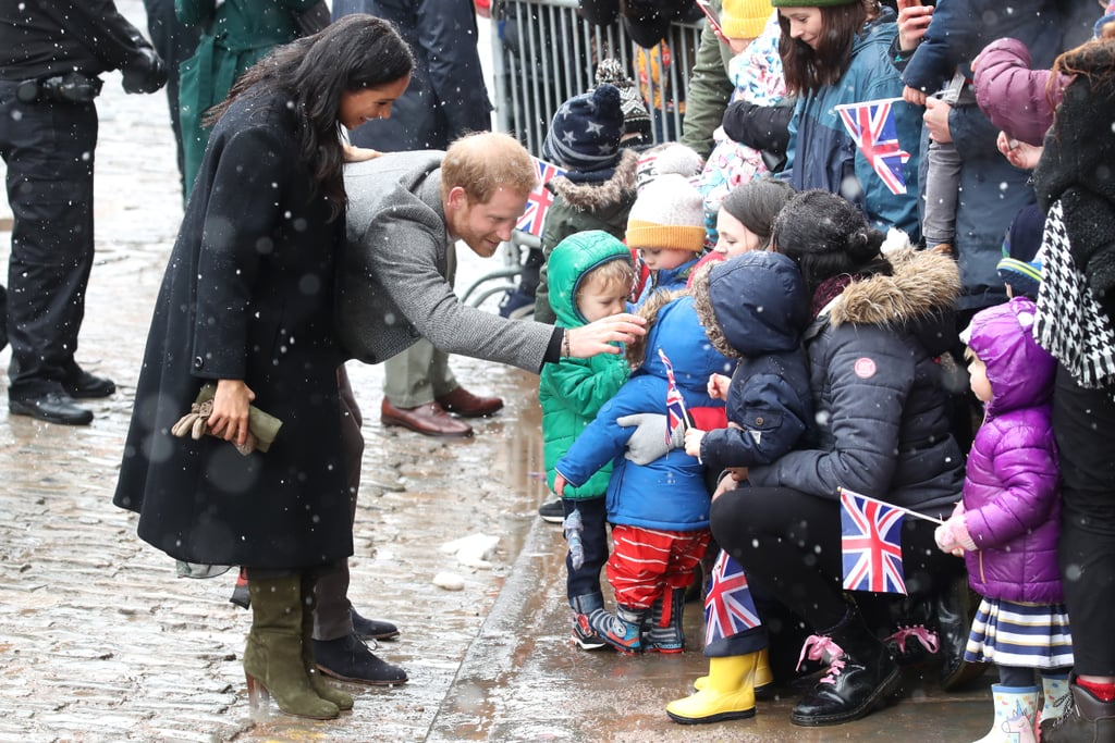 "The Duke and Duchess of Sussex braved the cold weather in Bristol, England. Despite the flurry of snow, Meghan and Harry took time to interact with an adorable group of toddlers from a local preschool, some of whom who were apparently wearing princess costumes under their coats. Meghan also showed that she's totally versed on British culture now, suggesting that everyone ""warms up and has a nice cup of tea afterwards.""  Their first stop was the famous Bristol Old Vic, which was built in 1766, making it the oldest continuously working theater in the English-speaking world. Their visit also included a trip to Empire Fighting Chance, to learn about how boxing ""aims to fight the impact of deprivation"" within the community. After spending the week at separate events, the two have reunited for this exciting royal engagement. Earlier this week, Meghan was busy making her first visits to her new patronages, including the National Theatre and the ACU. Prince Harry, meanwhile attended a Commonwealth roundtable this week as part of his new role as Commonwealth Youth Ambassador. Now that they're back together, get a look at all the adorable snow-filled photos from their visit to Bristol, then get details on Meghan's boots and animal printed dress.      Related:                                                                                                           The Touching Reason People Are Comparing Meghan Markle's Latest Outing to Princess Diana"