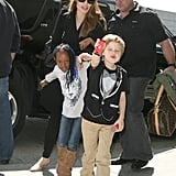 Angelina Jolie Jets Out of Town With Smiley Shiloh and Zahara