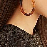 Grab a pair of brand-new hoops, like the Dinosaur Designs Resin Hoop Earrings — Tortoiseshell ($125).