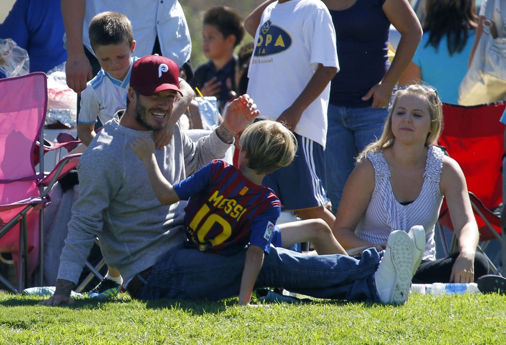 David Beckham horsed around with his boys Cruz and Romeo.