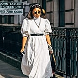Pair your favorite white summer dress with a belt and cowboy boots to bring your look western flair.