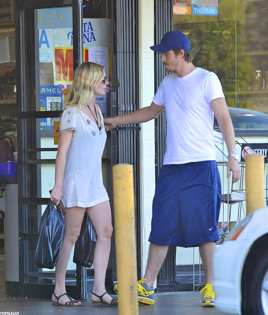 Kirsten Dunst showed off her legs in a white cover-up while out with her boyfriend, Garrett Hedlund, in LA on Sunday. Garrett was quite the gentleman, holding the door for Kirsten, as they headed out of a market together. The couple are enjoying some down time after returning home from Toronto, where they promoted their upcoming joint project. Kirsten and Garrett hit the red carpet with Kristen Stewart for the TIFF premiere of On the Road, a film that holds special significance for the stars, since Garrett and Kirsten met on the set.  Kirsten has kept a busy schedule lately, having also embarked on a press tour for Bachelorette earlier this month. She nonetheless snuck in some fashion fun between promotional appearances. Last week, Kirsten sat front row at the Rodarte show during NYFW.