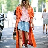 Go sporty-chic with a striped tee, colorful jacket, and bright sneakers.