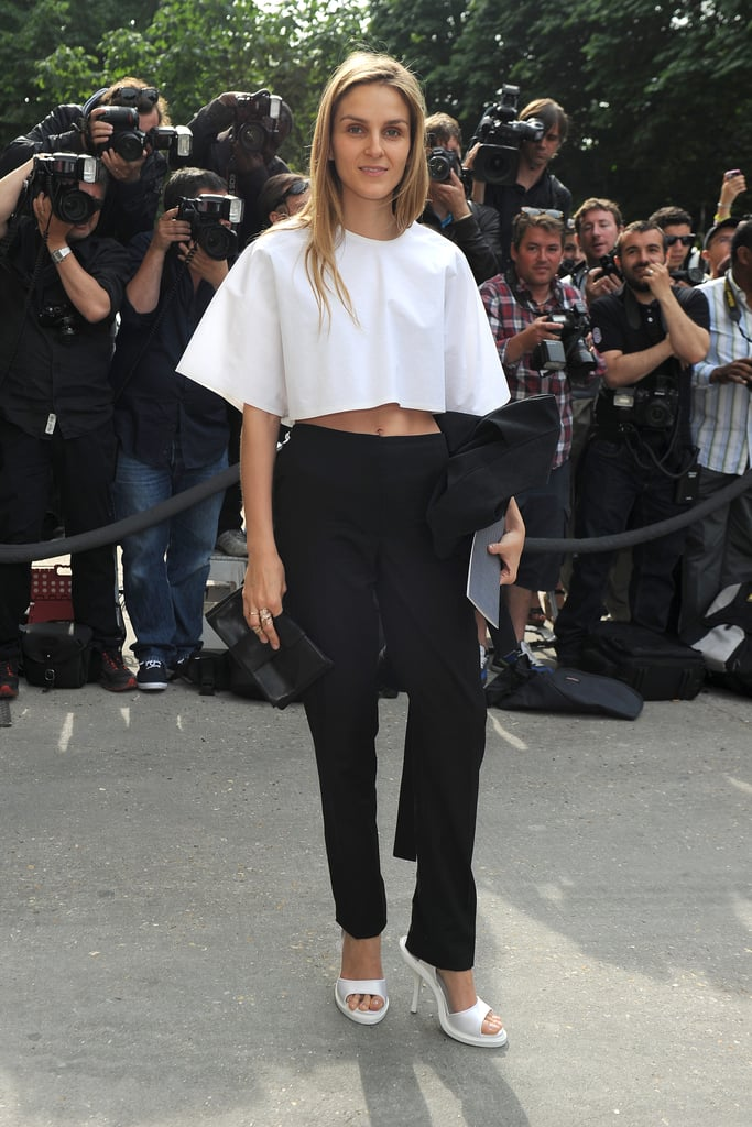 Jewelry designer Gaia Repossi kept it simple at the Chanel show, pairing black trousers with a voluminous white crop top and sandals.