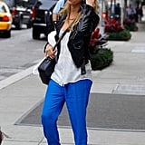 Jessica Alba sported bright blue pants.