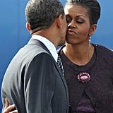 Michelle kissed Barack goodbye in Britain, as she headed back to the US to see their girls.