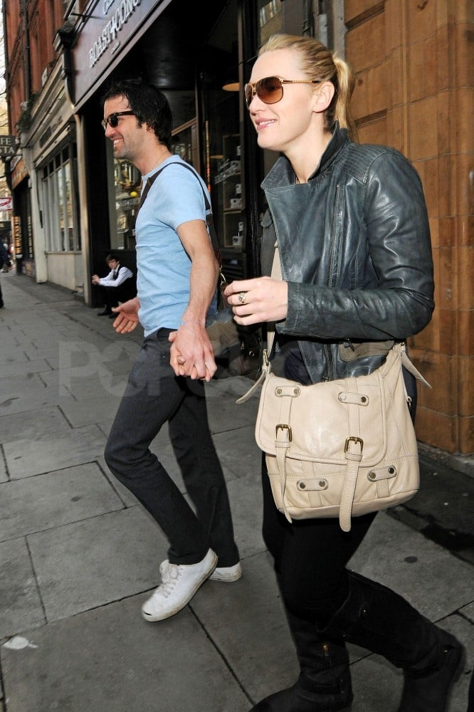 "Kate Winslet held hands with boyfriend Ned Rocknroll leaving a boutique in London on Saturday. The couple were all smiles and shared a hug while shopping around Covent Garden. Kate's schedule takes her to NYC today where she's expected to make an appearance on Live With Kelly! It's been almost 15 years since Kate and Leonardo DiCaprio set sail on the Titanic, and they're making a return to the big screen April 4 when Titanic 3D opens nationwide. Kate's excited to share the film with her children, Mia and Joe, though she's not so thrilled to see herself in 3D. In a recent interview Kate joked about seeing herself in 3D, ""Oh my God, that's me. Block my ears, somebody! Somebody club out my senses. Make it f***ing stop!"""