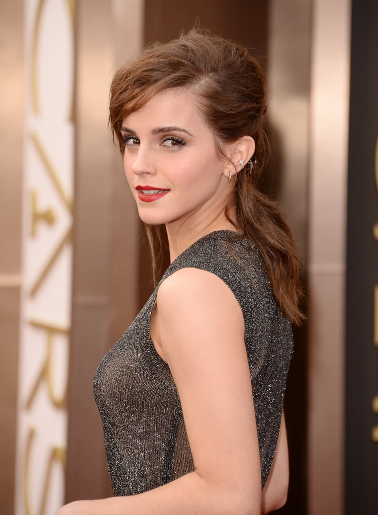 We remember the half-up, half-down hair style from the '90s and now Emma Watson is bringing it back! She rocked it on the red carpet at the Oscars with an edgy twist though, wearing it tousled with flyaways and a side part to keep it modern. To contrast, Emma sported a classic red lip colour and minimal eye makeup, letting her strong brows do the talking.  How do you feel about this blast from the past?Vote on all ourAcademy Awards polls here!