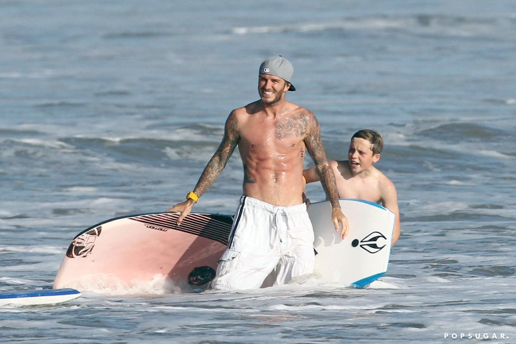 David Beckham showed off his washboard abs when he went boogie boarding with son Brooklyn in Malibu back in August 2011.