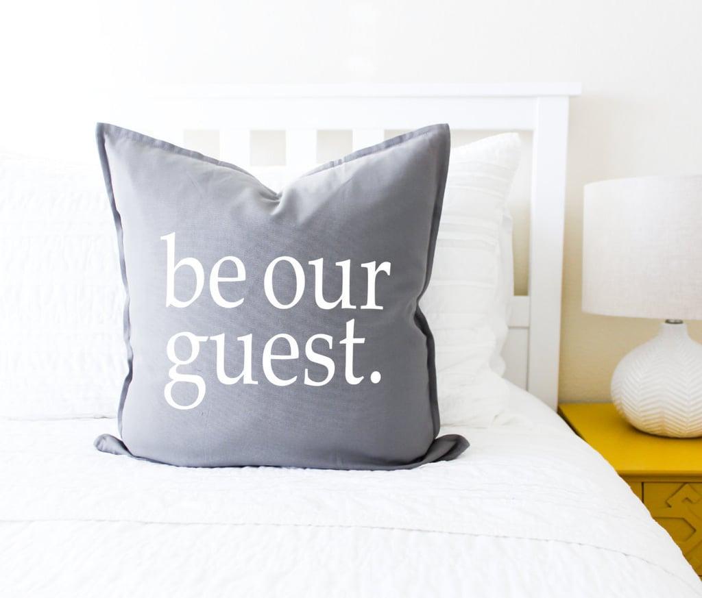 وسادة Be Our Guest  (بسعر 20$ دولار أمريكي؛ 74 درهم إماراتي/ريال سعودي)