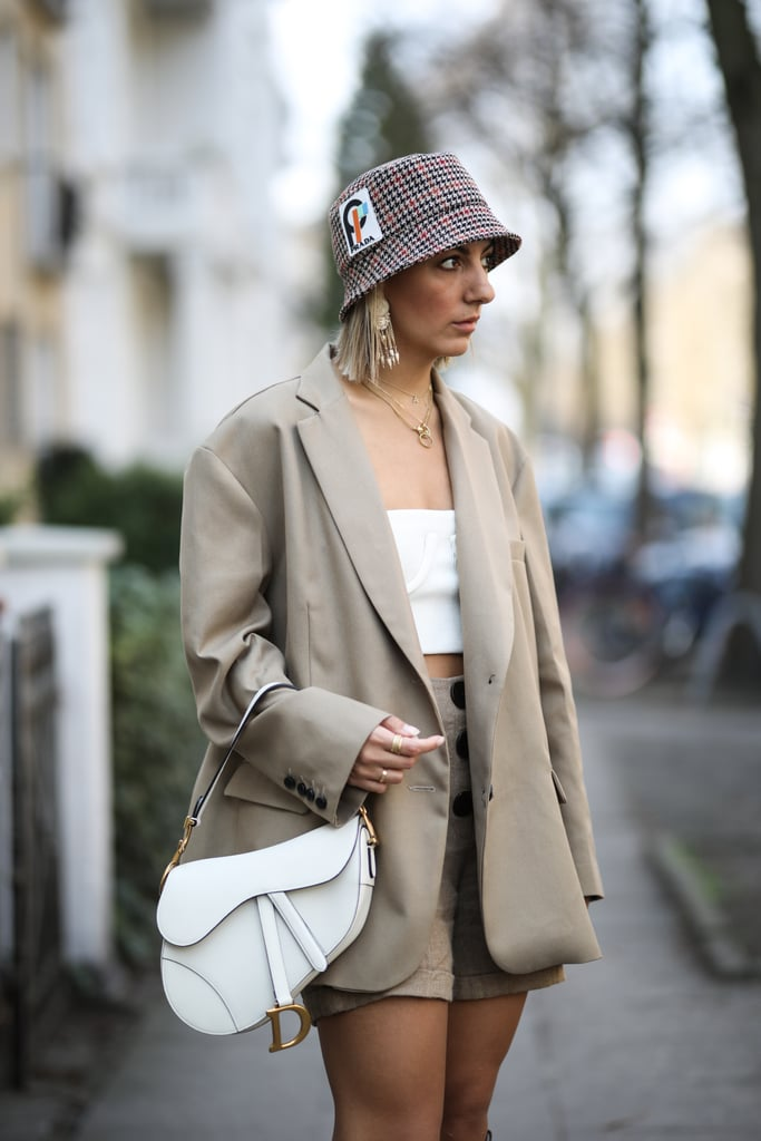 Style a beige set with a bucket hat and tube top for a '90s look.