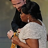 Christian Bale helped Octavia Spencer walk offstage during the 2012 Oscars.