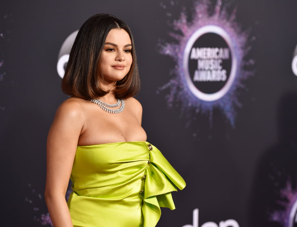 "Selena Gomez showed up and shined at the American Music Awards on Sunday night. The 27-year-old singer opened the show, and she certainly made an incredible statement when she hit the red carpet in a lime green ensemble.  The show marks an exciting AMAs return for Selena. She last performed at the show two years ago, so you can imagine the excitement around her first televised performance of her hits, ""Lose You to Love Me"" and ""Look at Her Now."" Keep reading for a glimpse at Selena's exciting night at the show."