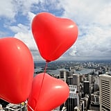 Heart-shaped balloons are tied to the summit of the Sydney Tower.