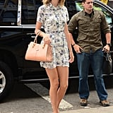 For a more retro-inspired look, Taylor opted for a collared floral dress, peep-toe pumps, and a nude handbag.