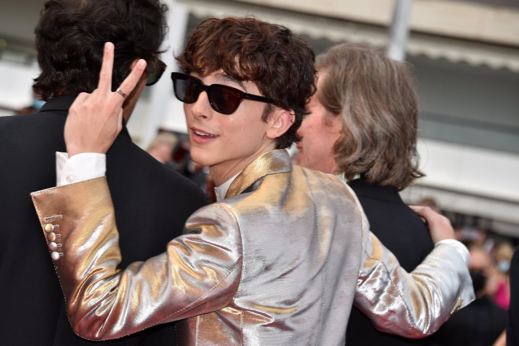 Hollywood's golden boy is giving us another reason to swoon. On July 12, Timothée Chalamet stood out among a sea of black suits in his silver ensemble for the French Dispatch's Cannes Film Festival premiere. This stylish selection was enough to ensure all eyes were on Chalamet as he walked the red carpet, but a closer look at his accessories revealed two ear piercings that truly stopped us in our tracks.  Chalamet rounded out his Cannes look with black hoops along his helix. His fans speculate that the earrings might be part of a makeover he underwent for his upcoming Bones and All film — the same role he dyed his hair orange for. Although Chalamet switched back to his darker hue for the red carpet, he did keep the mullet style in place. The piercings might've been a keeper too — we certainly hope they stick around. Get a closer look at Chalamet's new piercings in the photos ahead.       Related:                                                                                                           Last Year's Biggest Piercing Trends Are Getting a Redo in 2021, According to a Pro