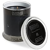 "Archipelago Botanicals candle ($19) in ""Stonehenge,"" with notes of smoked cedarwood, bergamot, and amber."