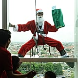 Santa Claus surprised children through a hotel window in Indonesia.