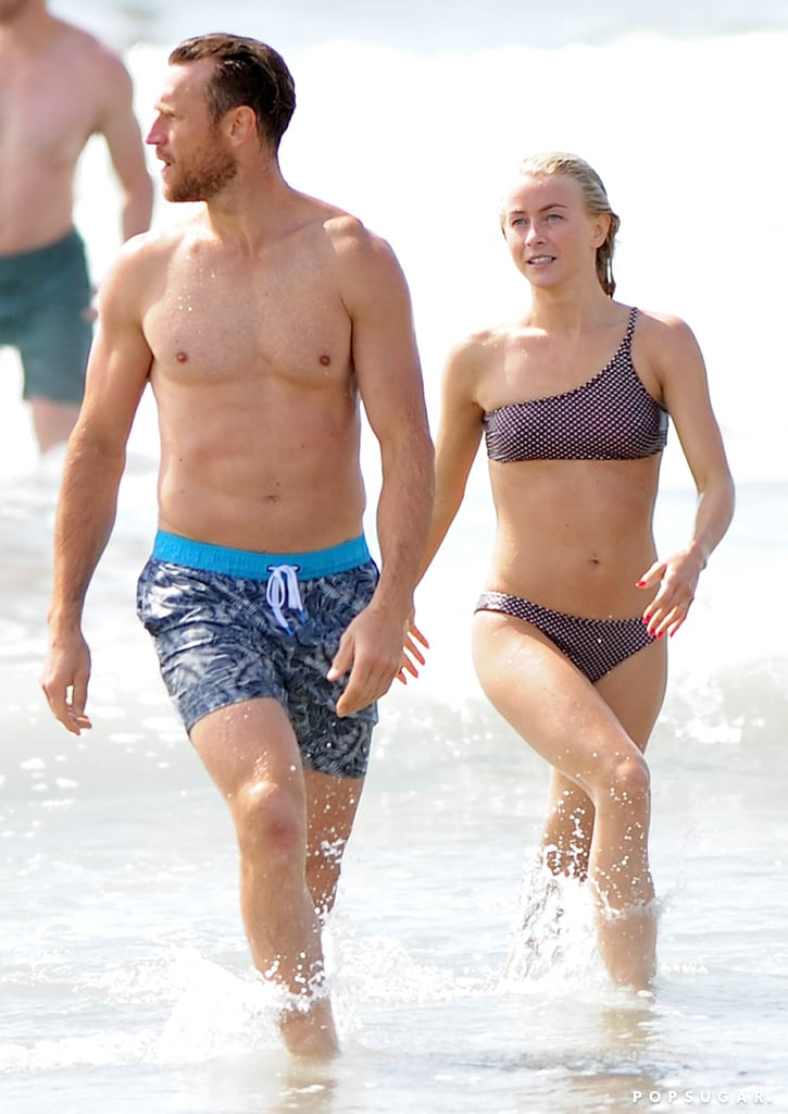 Julianne Hough and Brooks Laich don't need the tropical shores of Seychelles to show off their sweet love. The couple, who tied the knot in Idaho in early July, enjoyed some fun in the sun as they hit up Manhattan Beach, CA, with friends and family on Labor Day. While Brooks donned a pair of blue shorts, the Dancing With the Stars judge showed off her washboard abs in a polka-dot bikini. Aside from braving the waves, the newlyweds enjoyed a nice walk on the beach as they greeted friends with a warm hug. They even had a friendly competition with Julianne's brother, Derek Hough, as they played games in the sand. See more of their fun-filled outing ahead.       Related:                                                                                                           The Story of How Julianne Hough Met Brooks Laich Will Make You Believe in Destiny