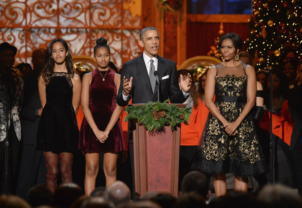 While Michelle was shining in a festive, floral frock at the 33rd annual Christmas in Washington event, Malia and Sasha wore velvet dresses, and Sasha's cranberry skater dress is available to shop at ASOS! Malia complemented her sister's look with her own red printed stockings.