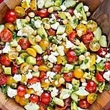 Tomato, Avocado, Cucumber, and Chickpea Salad With Feta and Greek Lemon Dressing