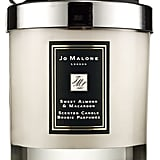 """A classic, but a goodie for that friend who has everything! Guaranteed to enhance the mood of any home or dorm room. This gift is a really nice gesture and perhaps will re-ignite your friendship.""   Jo Malone Sweet Almond & Macaroon Home Candle   ($65)"