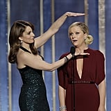 """Tina and Amy killed it as Golden Globes hosts. Their opening monologue included jokes like Amy's quip: """"It was a great year for women in film — Kathryn Bigelow, nominated tonight. I haven't really been following the controversy over Zero Dark Thirty, but when it comes to torture, I trust the lady who spent three years married to James Cameron."""" And Tina tickled our funny bone with this line: """"This next presenter is so good-looking, he makes young George Clooney look like garbage. Please welcome, middle-aged George Clooney."""""""
