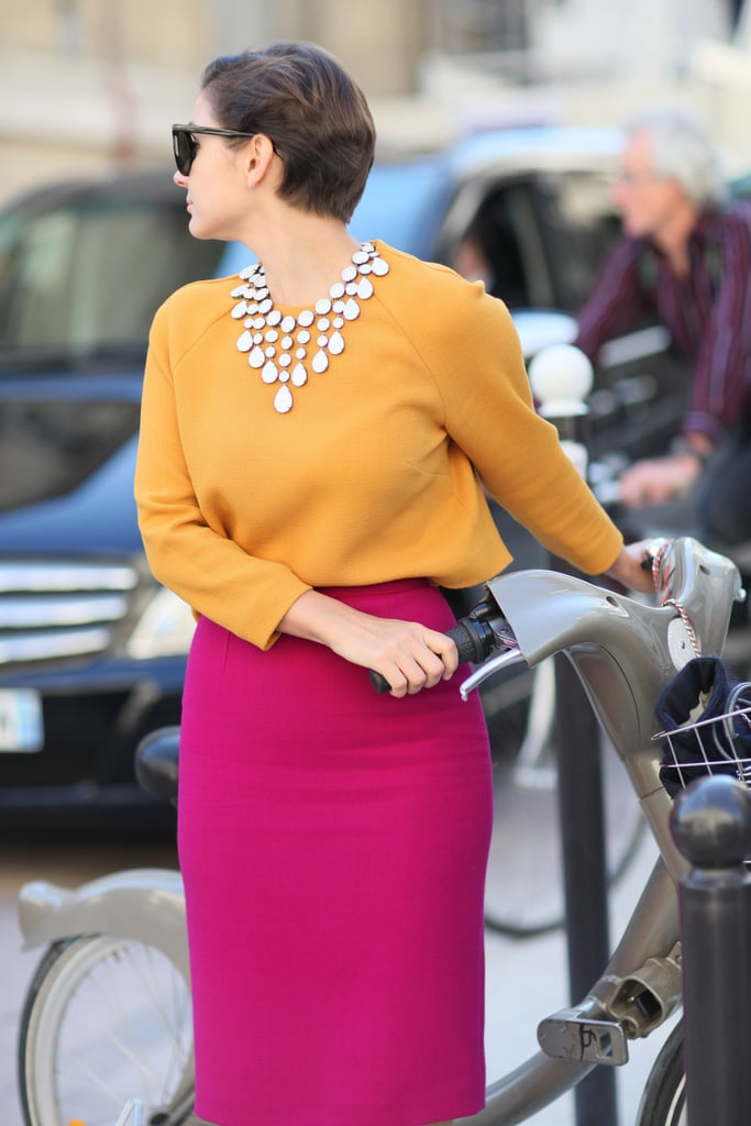 A jeweled bib necklace lent a glam finish to ladylike colorblocking.