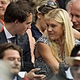 Chelsy Davy sat in the stands at Wimbledon with a man.