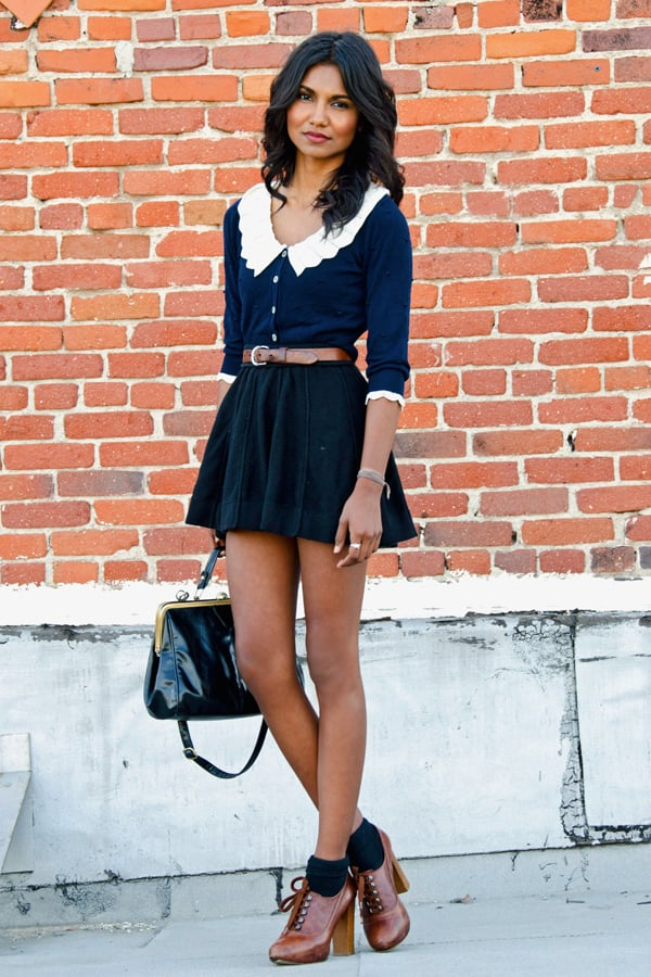 Take the ladylike route with a collared blouse and a full skirt — note: this looks even sweeter with her socks and heels. Source: Lookbook.nu