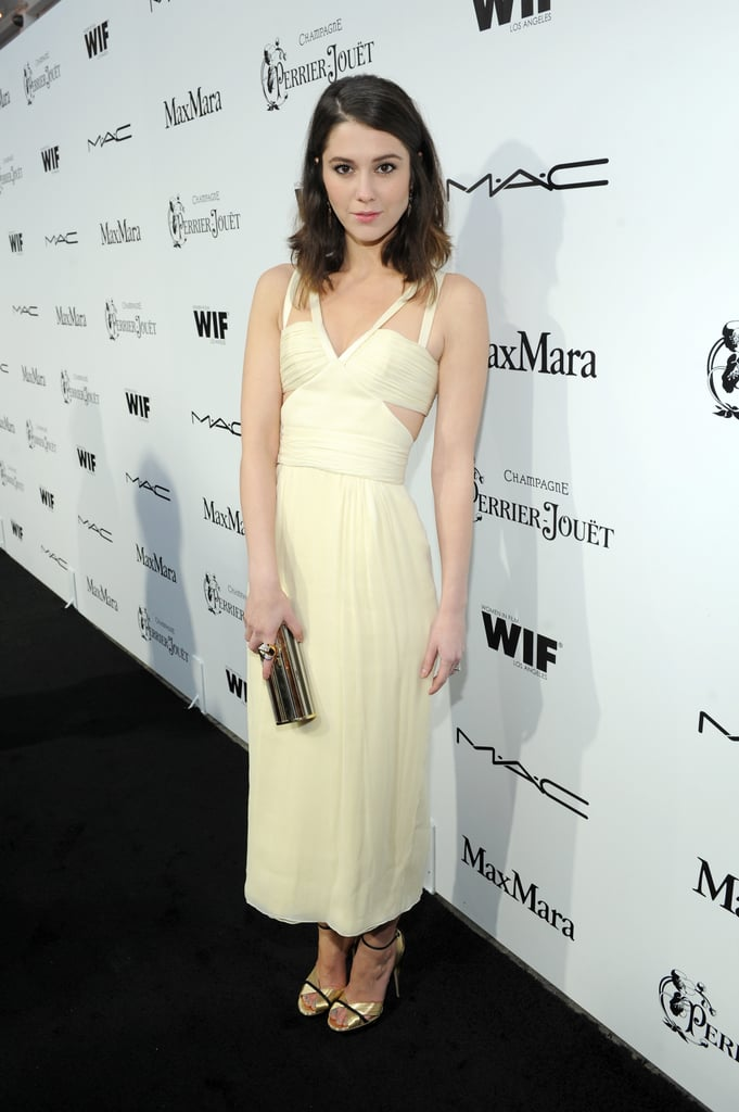 Mary Elizabeth Winstead looked elegant in a cream-colored cutout dress, metallic sandals and a matching clutch, both by Jimmy Choo, for the 6th Annual Women in Film Pre-Oscar party in LA.