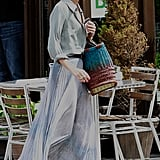 Olivia Palermo embraced the season with a breezy maxi and woven accessories — plus her signature ballet flats.