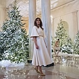Melania wore a pleated Dior dress while touring the Christmas decorations in the White House in November 2017.
