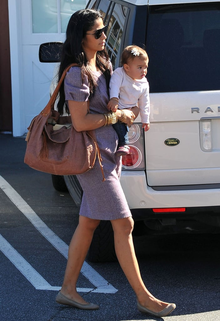 Camila Alves had Vida on one arm and her Muxo handbag on the other while out at the Brentwood Country Mart in LA yesterday. It was a fun mother-daughter outing for Camila and Vida, after the mother of two had one-on-one time with Levi over the weekend. Matthew McConaughey took his turn with the kids on Saturday, when they headed to the beach in Malibu for a family workout session. Matthew, Camila, and the kids have been hanging out close to home since returning from their New Year's trip to Brazil, where they were joined by country singer and pal Jamey Johnson. MM directed Jamey's music video last year, just after he finished filming The Lincoln Lawyer. We'll get to see more of MM's hard work soon, as a new trailer for the movie debuts on his Facebook page tomorrow.