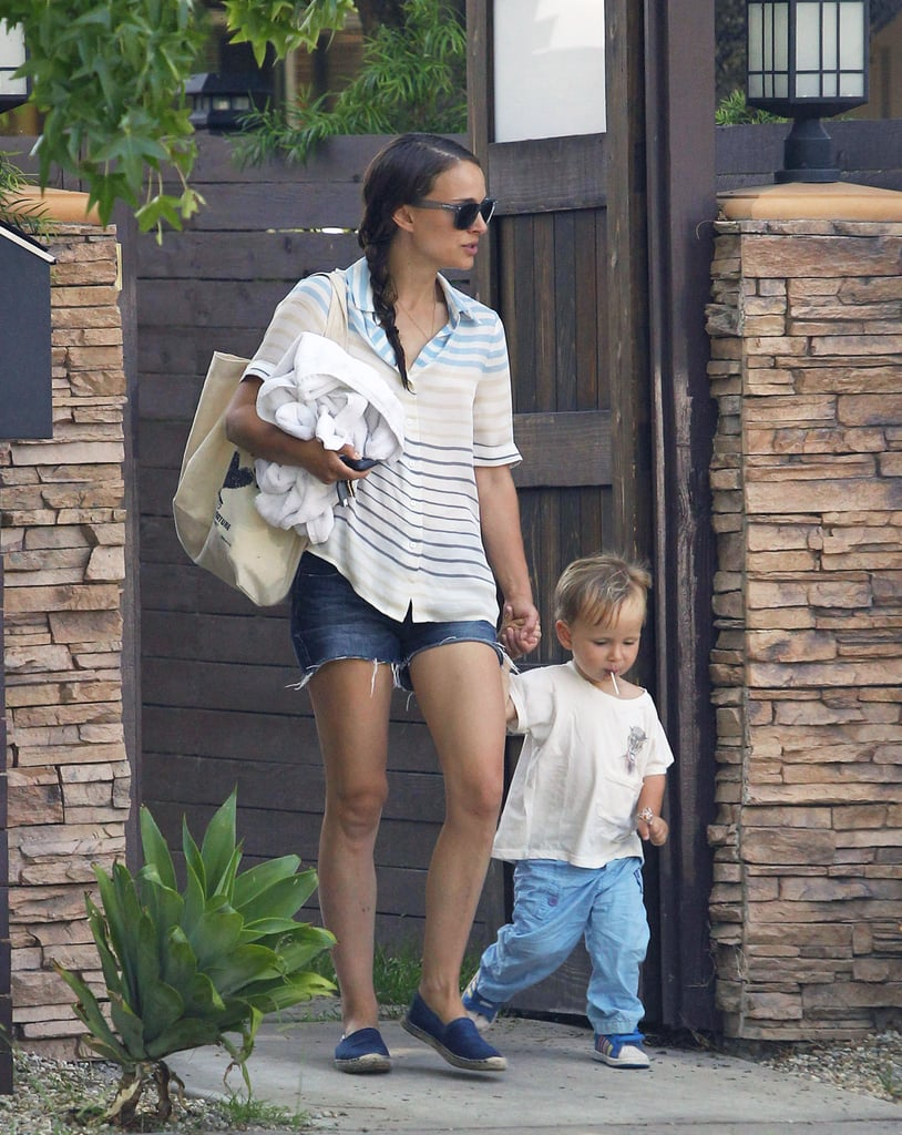 Natalie Portman stepped out with her lollipop-loving son, Aleph, on Thursday in LA. Natalie kept things casual with a pair of denim cutoffs while Aleph doubled up on lollipops — one in his mouth and one in his fist. The adorable pair walked hand in hand as they headed out for some mother-son time. We saw the duo out with Natalie's husband,  Benjamin Millepied, for a fun-filled Fourth of July weekend with strolls through the Little Tokyo district and a day at the park. Natalie and Benjamin also enjoyed a date night last month when they saw the Legends of the Summer tour at the Rose Bowl, watching Justin Timberlake and Jay Z perform with other famous fans like Robert Pattinson and Jessica Alba in the crowd. Natalie's style took a dressed-up turn over the weekend when she attended Disney's D23 Expo in Anaheim. The actress was all smiles while chatting to the press alongside her Thor: The Dark World costar Tom Hiddleston.