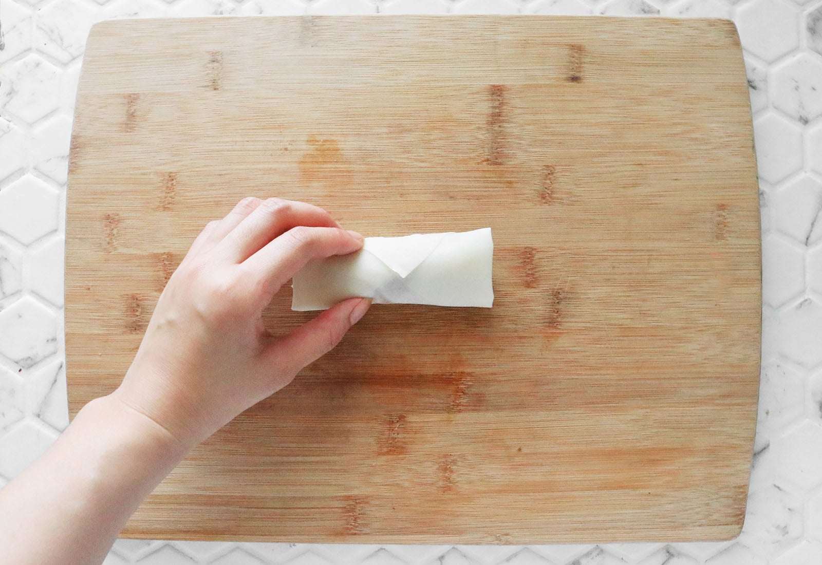 Roll up turon and seal wrapper
