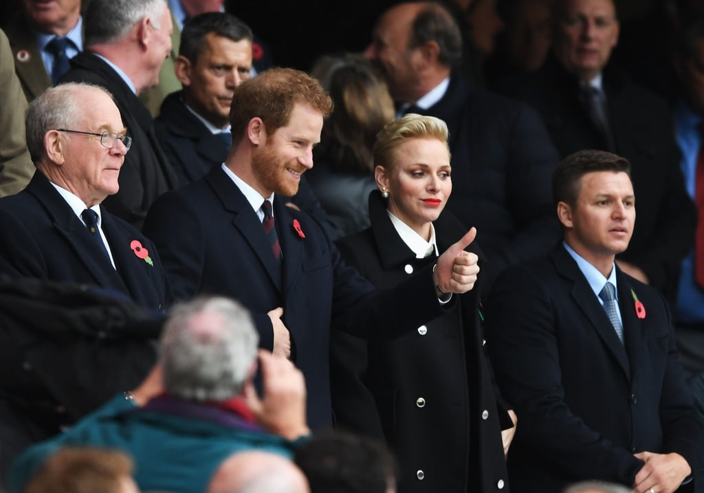 Prince Harry took time out of his busy schedule to attend a rugby match between England and South Africa in London on Saturday. Upon his arrival, the young royal laid down a wreath at the Rose and Poppy Gates, which were sponsored by the Rugby Football Union and commemorate the soldiers who lost their lives in World War I. Once inside Twickenham Stadium, Harry joined Princess Charlene of Monaco in the stands, where he happily took in the game and cheered on the athletes.  Harry's outing comes just two days after he visited the Field of Remembrance at Westminster Abbey with his grandfather, Prince Philip, and ahead of his 14-day Caribbean tour. During his visit, which kicks off on Nov. 20, the royal is set to meet Rihanna, learn about turtle conservation projects, replant coral reefs, and spend six nights on a Royal Fleet Auxiliary Wave Knight vessel that is used for disaster relief. Needless to say, Harry has a jam-packed schedule ahead of him.      Related:                                                                                                           Everything There Is to Know About Prince Harry and Meghan Markle's Royal Relationship