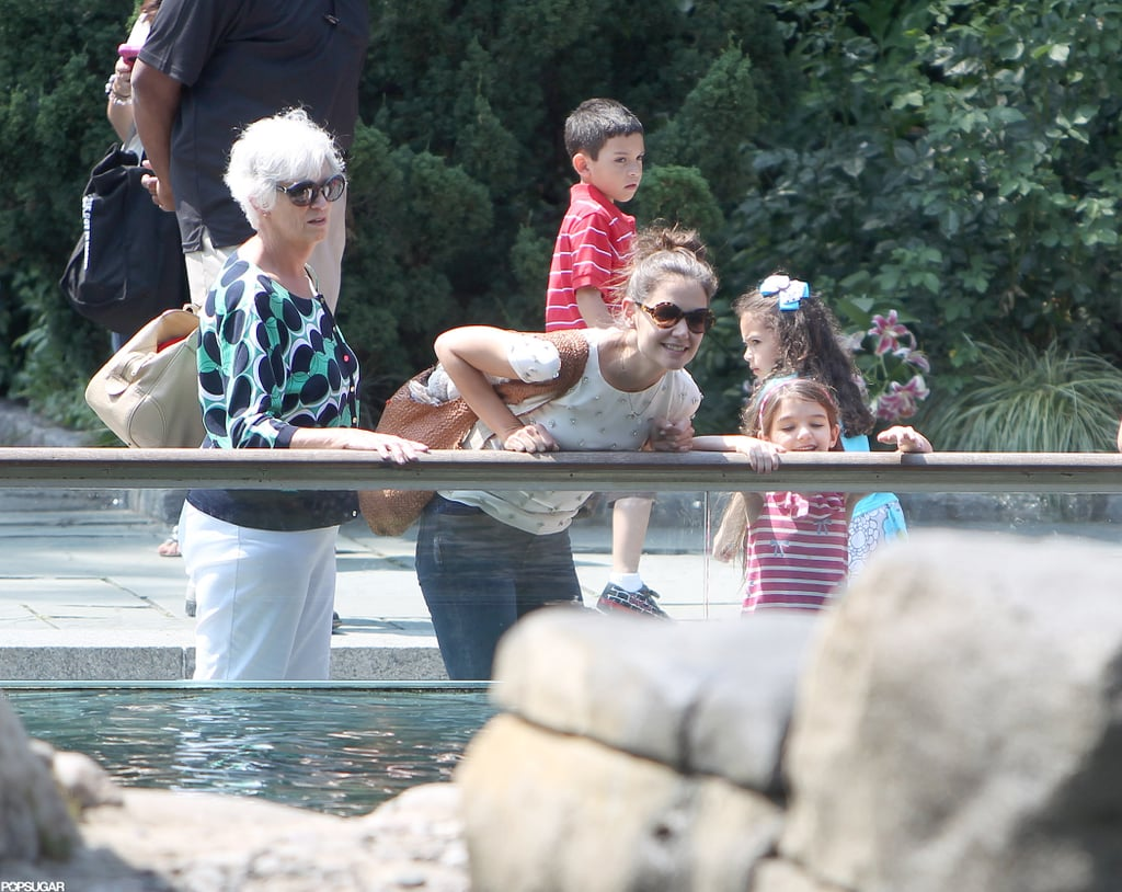 Katie Holmes had her mother, Kathleen Holmes, along as she took Suri Cruise for an afternoon at the Central Park Zoo today. The trio were spotted checking out the penguin exhibit together, and Suri pressed up close against the glass to get a glimpse of the birds swimming by as Katie looked on with a smile. The trip was a fun respite during what's been a tumultuous month for Katie and family. She and Tom Cruise announced that they had amicably settled their split over the weekend, just 11 days after Katie initially filed for the divorce. Suri will reportedly live primarily with Katie under the terms of the agreement, and it appears the mother and daughter will be staying put in NYC for the time being. Meanwhile, Tom is focusing on work as he shoots Oblivion in California. Get the latest details on how Katie and Tom are coping with their divorce in today's PopSugar Rush.