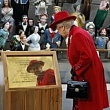 The queen viewed a plaque commemorating the official reopening during a visit to the Cutty Sark in London.