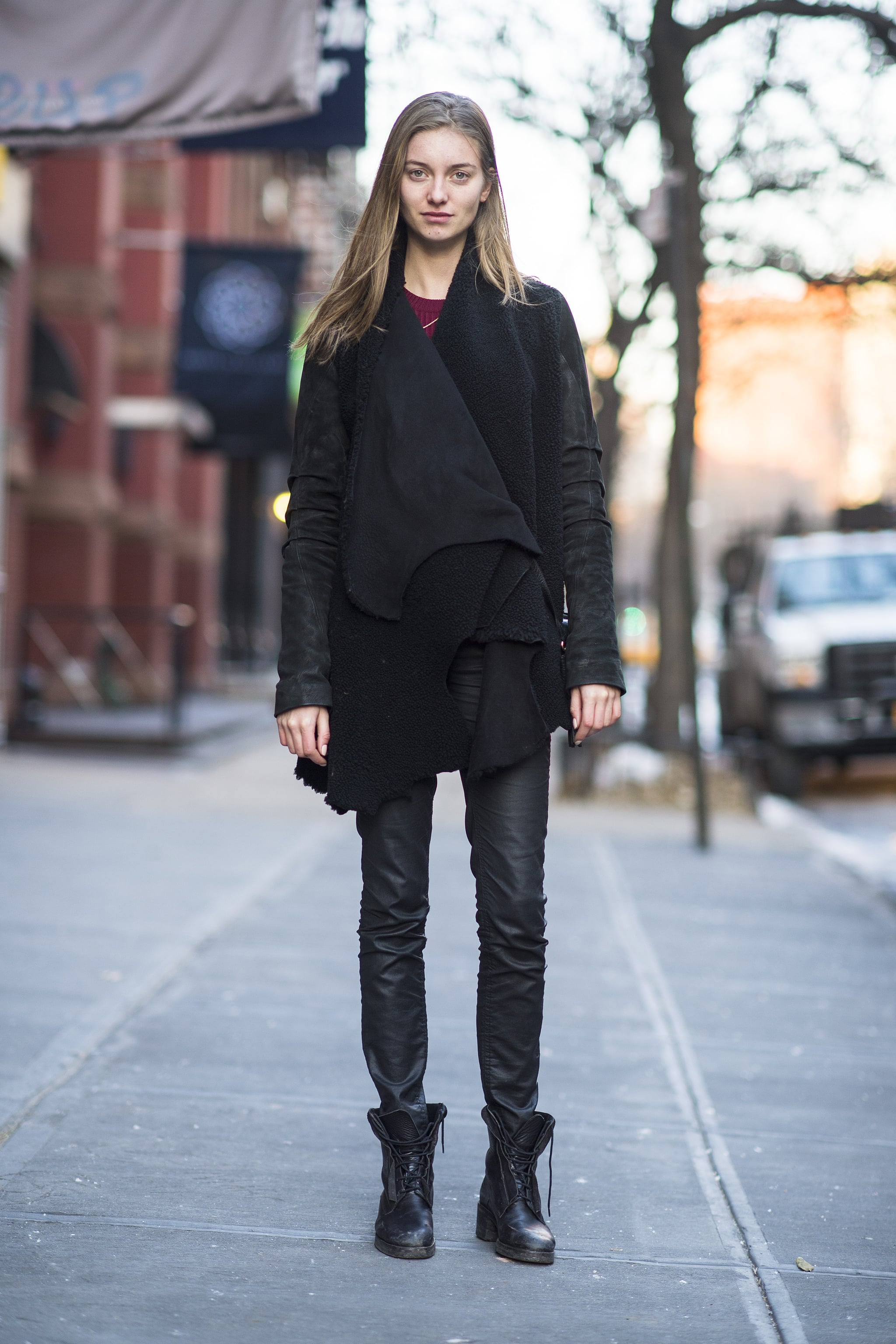 Sure, it's simple, but this all-black look scores points with a little leather and a pair of tough-girl boots.  Source: Le 21ème   Adam Katz Sinding