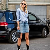 Go Western-chic with denim miniskirt, button-down shirt, and cowboy boots.