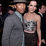 Sandra Bullock stopped to pose for photos with Pharrell Williams inside the bash.
