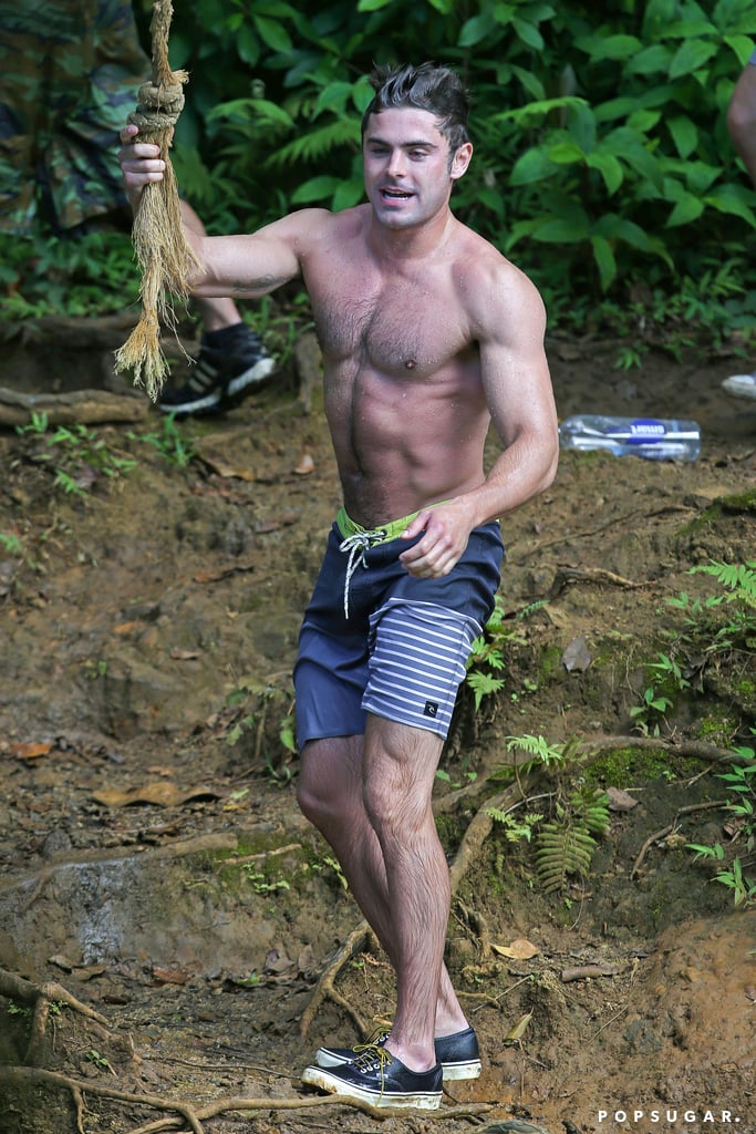 Zac Efron's shirtless physique was on display during an afternoon of rope swinging in Oahu, HI, with his Mike and Dave Need Wedding Dates costars Adam DeVine and Aubrey Plaza on Sunday. We have to say, of all the times we've seen Zac shirtless, this might just be his hottest yet!   Zac has been on the island working on the movie for the last few weeks but has managed to fit in plenty of time for his own tropical adventures. He and girlfriend Sami Miró hit the beach at the end of May, and he also met up with Aubrey and Adam for a hike over Memorial Day weekend.
