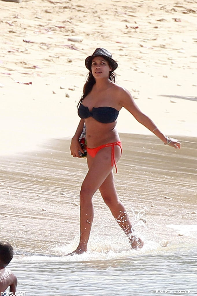 Rosario Dawson wore a black and red bikini.