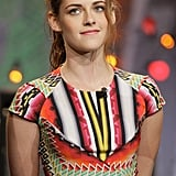 Sharp lines, a saturated optic print, exposed stitching at the waist, and structured cap sleeves: this was one dynamic ensemble, courtesy of Kristen Stewart and Peter Pilotto.