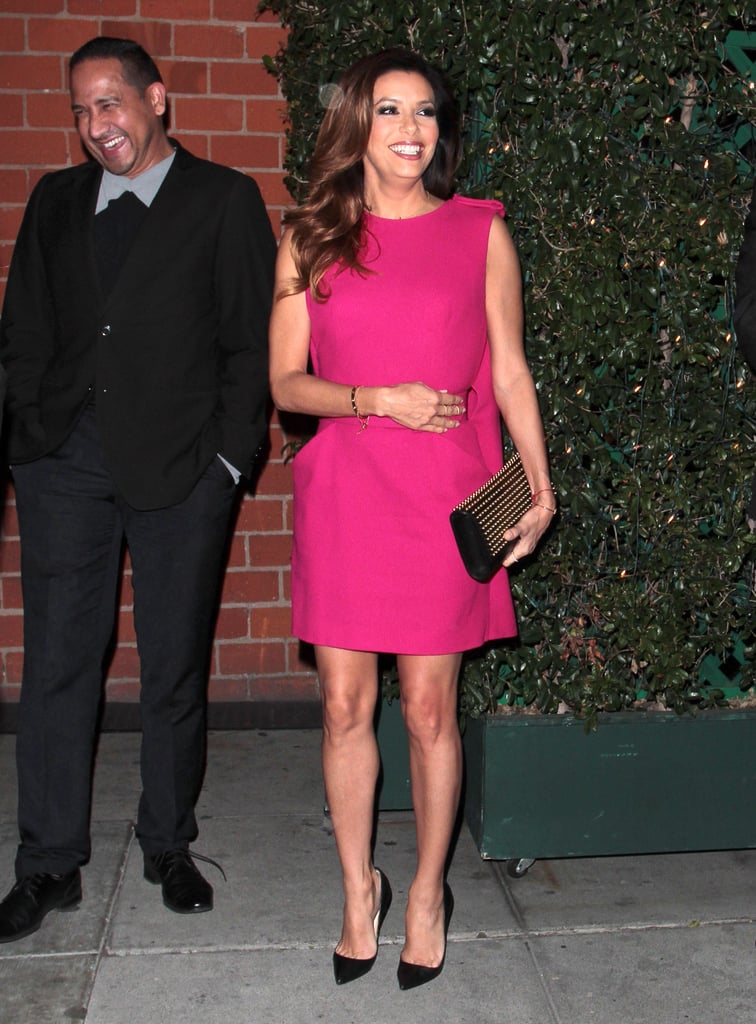 A fuchsia mini, black pointed pumps, and a studded Saint Laurent clutch was Eva Longoria's look of choice for a December 2013 date night. Where to Wear: A comedy show.