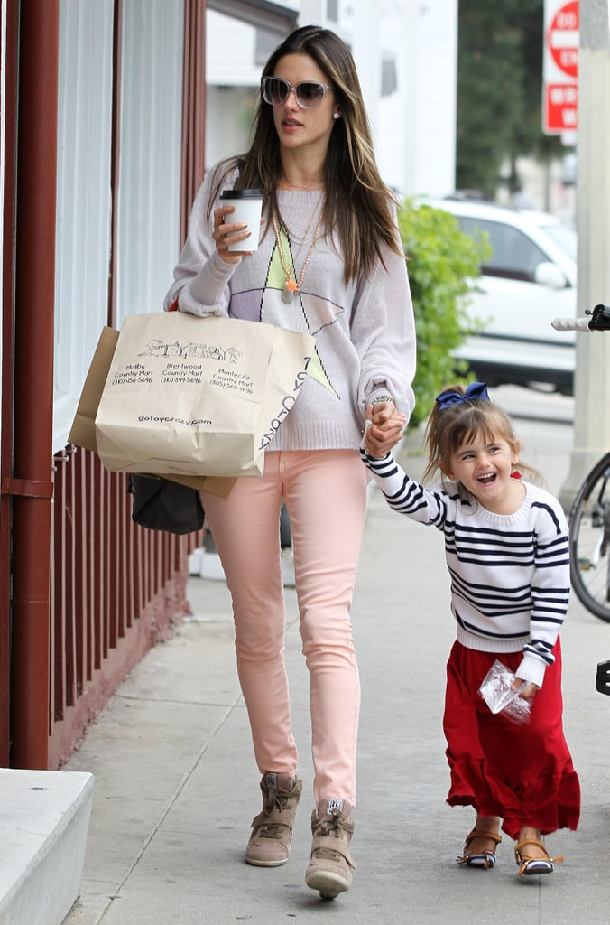 Alessandra Ambrosio held daughter Anja's hand for a shopping trip in LA on Saturday.