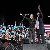 Holding hands, the Obamas greeted the crowd.
