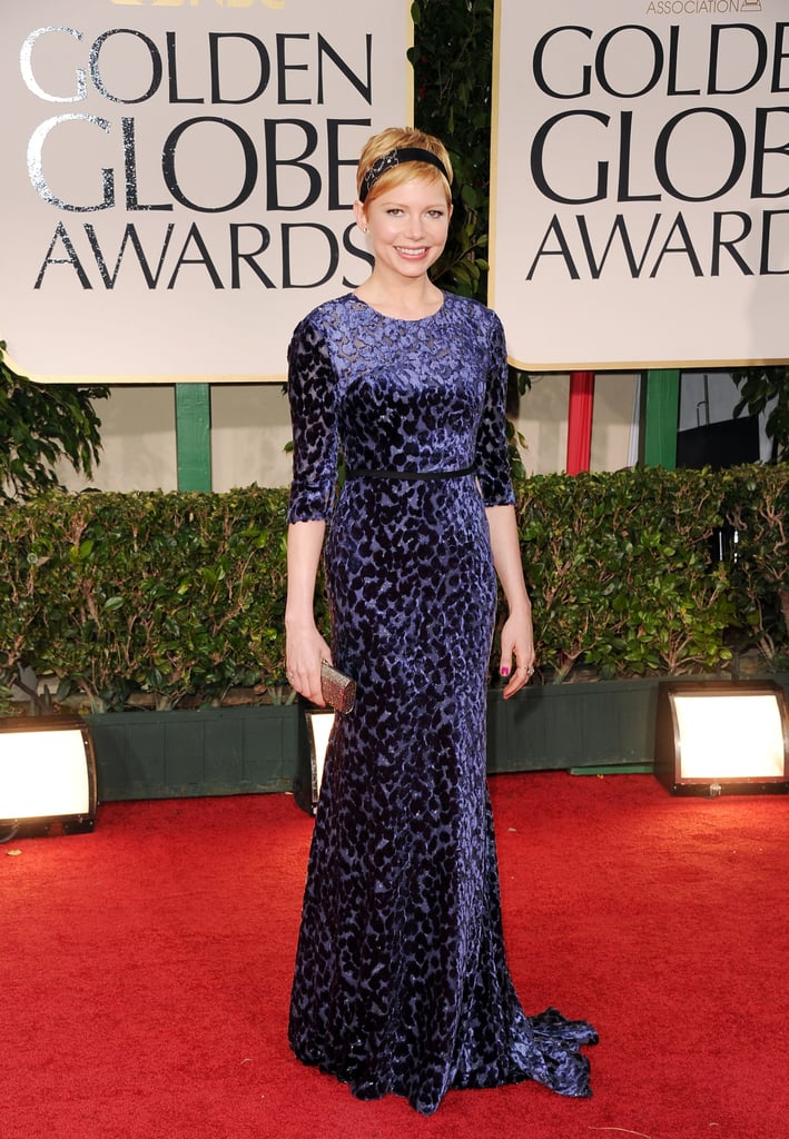 Michelle Williams picked Jason Wu for her big Golden Globes appearance this evening. She paired the blue, velvet-embellished frock with a Judith Leiber bag and a vintage Fred Leighton headband. Michelle is nominated for best actress in a drama today thanks to her role in My Week With Marilyn. The picture also earned a best supporting actor nod for Kenneth Branagh, as well as a nod in the best comedy or musical category. Michelle brought her friend Busy Philipps along for their third girls-only Golden Globes. We're excited to see fun pictures of the girls at the assorted afterparties, whether or not Michelle takes home a win! Weigh in on Michelle's look by voting on Fab and Bella's fashion and beauty polls.