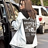 The back of her denim jacket even held a surprise, featuring graphics and quotes.